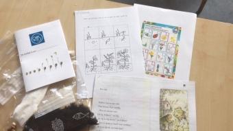 Een zakje aarde, bonen om te zaaien, groeiboekje, een verhaal van Kikker en Pad over de tuin en een lentebingo.
